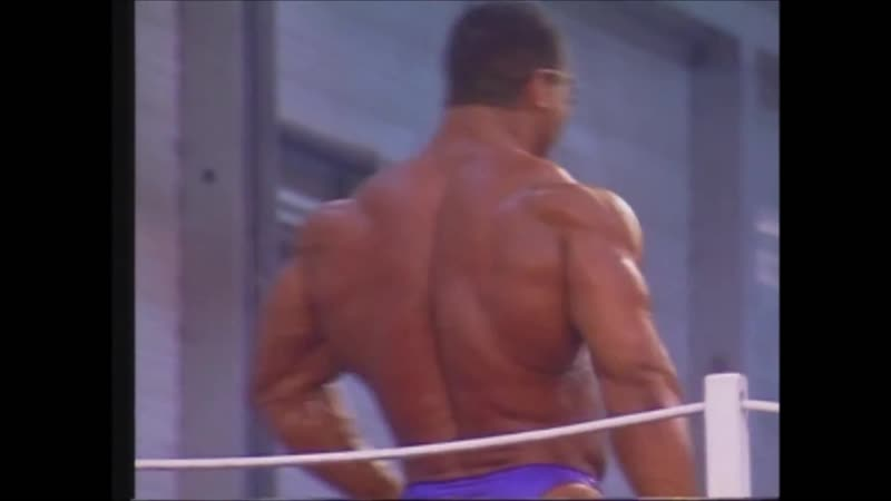 The Amazing Nasser El Sonbaty Posing on Stage Available at Prime Cuts Bodybuilding DVDs