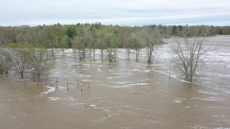 Floodwater pours through Midland County dam