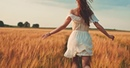 AURORA - Runaway - beautiful girl running on sunlit wheat field slow motion, freedom concept happy woman having
