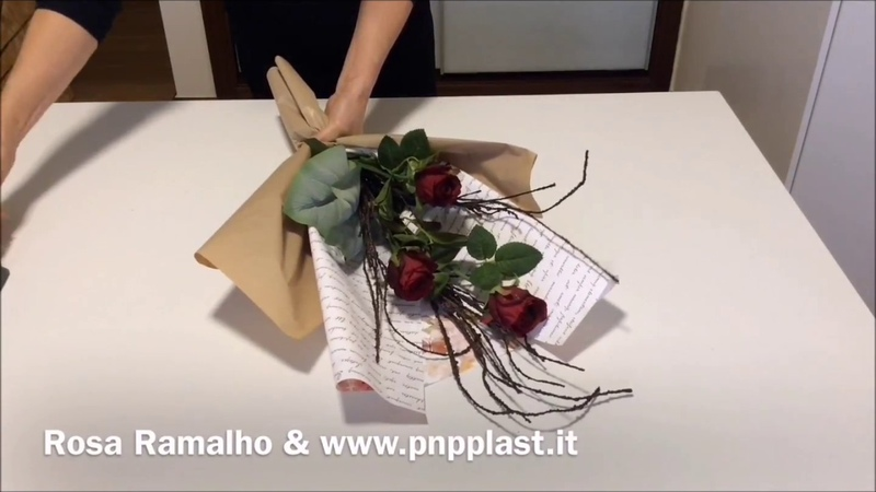 Wrapping roses with double cellophane and tissue paperwrapflowers