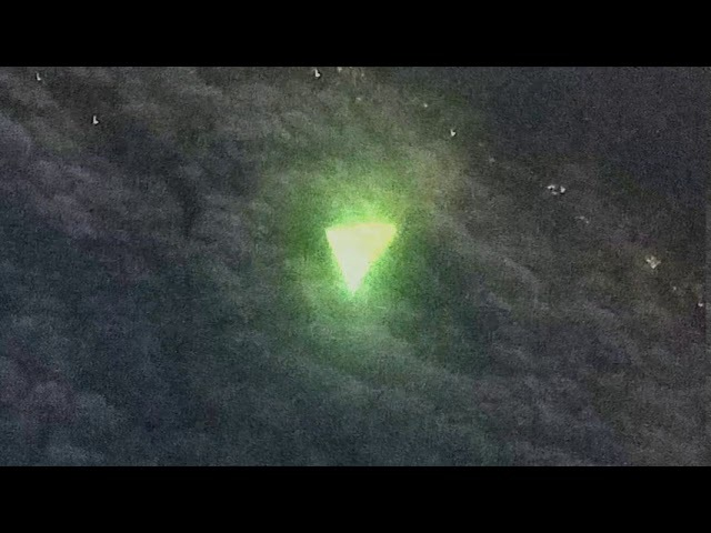 Triangular UFO photographed by an airplane passenger over Texas