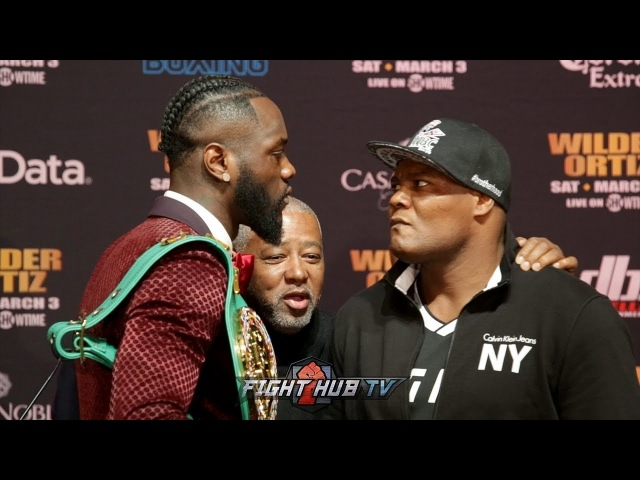 DEONTAY WILDER POPS OFF ON LUIS ORTIZ AT FACE OFF! BOTH SHARE HEATED STARES AT FINAL PRESSER