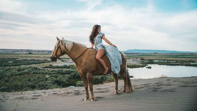 Beautiful Model and Horse in the Sand Dunes